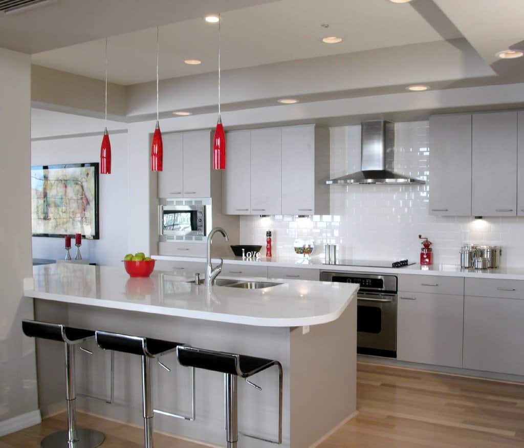 gray stained cabinetry, accented with red pendant lights