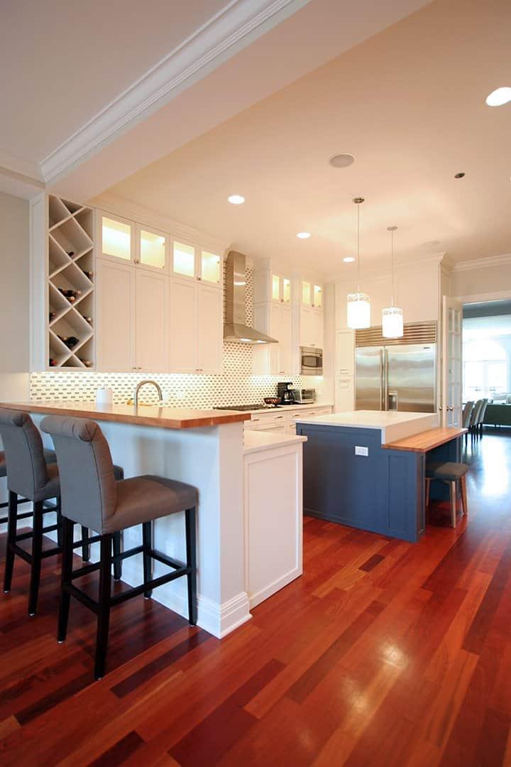 navy blue kitchen island with bench in white kitchen