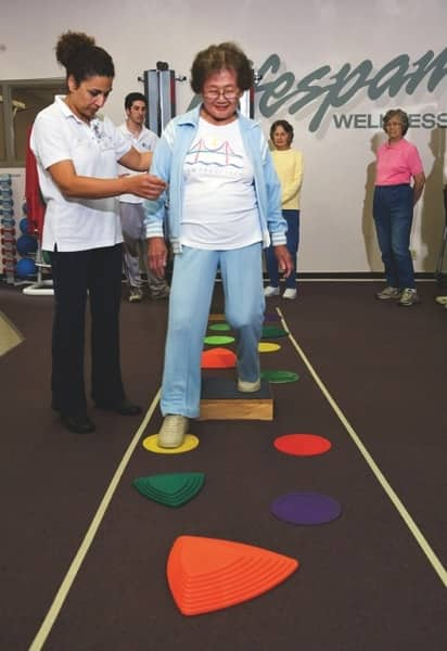 "Kimiko Kinoshita performs a ""creek walk"" activity designed to improve body control at the Center for Successful Aging. (Photo courtesy of Sally Aristei Photographs)"