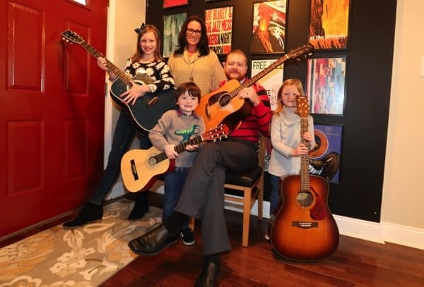 The musically inclined Frizzell family — Zach, Julia, Anita, Julian, and Charlotte — feared they might have to spend Christmas in a hotel room after their furnace died on Dec. 23rd. (Photo by Steve C. Mitchell)