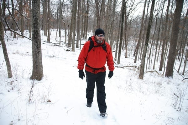 After undergoing ACL reconstruction surgery in April, John Ruggles, at Eagle Creek Park in Indianapolis, has returned to activities he enjoys, such as hiking. (Photo by Steve Mitchell)