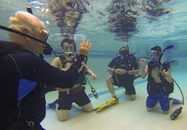 Instructor Darryl Koch (left) oversees a scuba class at the Hendricks County Regional Health YMCA. (Photo by Eldon Lindsay)