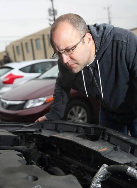 Tom Moor under car hood