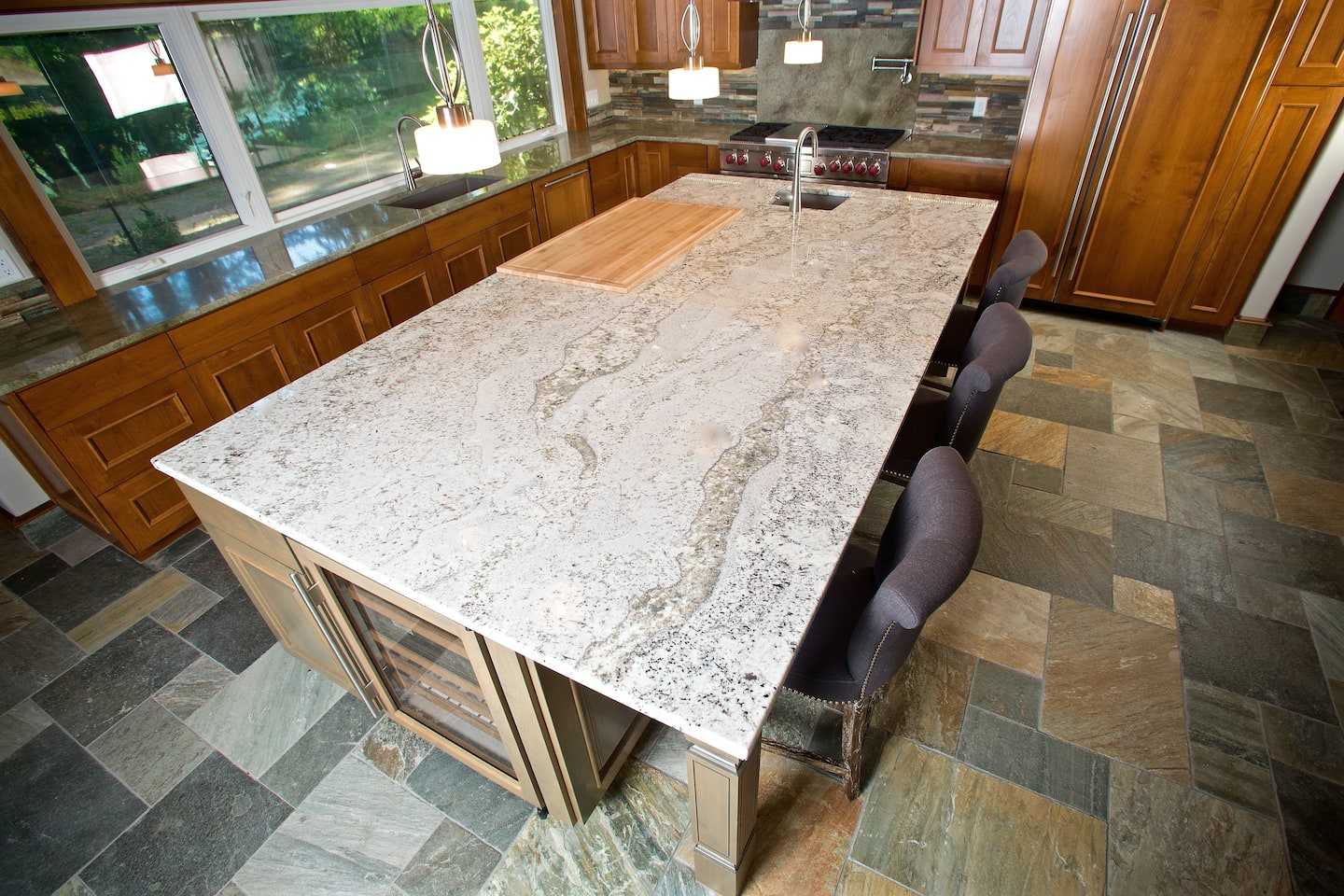 Granite kitchen countertop designs and styles angie 39 s list for Granite countertop width