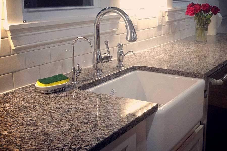 granite countertop with farmhouse sink