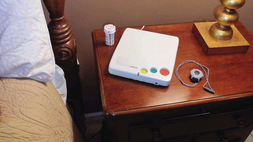 medical alert machine on nightstand