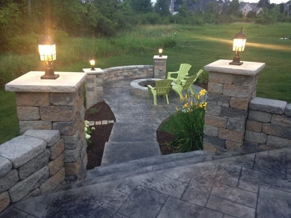 1st Impressions Colored Stamped Concrete installed a new fire pit, retaining wall and patio. (Photo courtesy of Angie's LIst member Frank M., of Medina, Ohio))