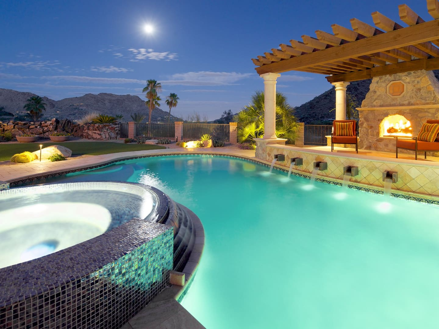 swimming pool with pergola and hot tub