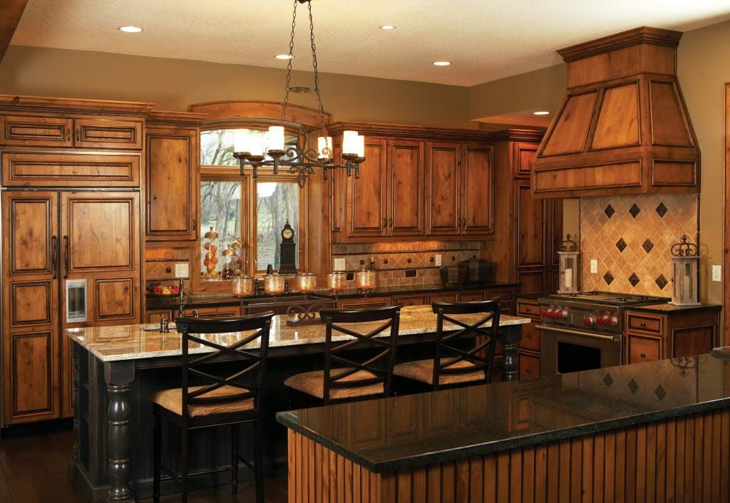 Kitchen with raised panel wood cabinets and two islands.