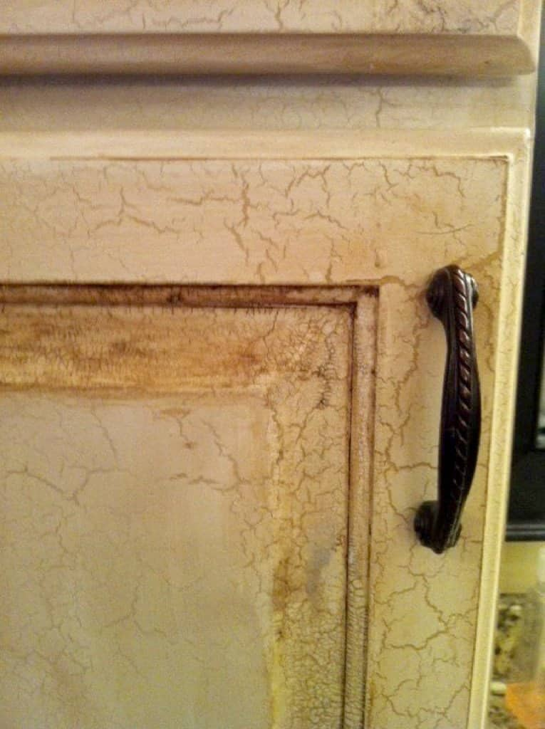 rope etched iron kitchen cabinet handle on crackle finished cabinet door.
