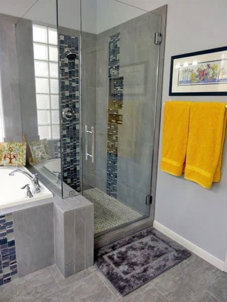 Three different types of tile highlight this bathroom's shower, floor and whirlpool. (Photo courtesy of Angie's List member Connie S. of San Antonio, Texas)