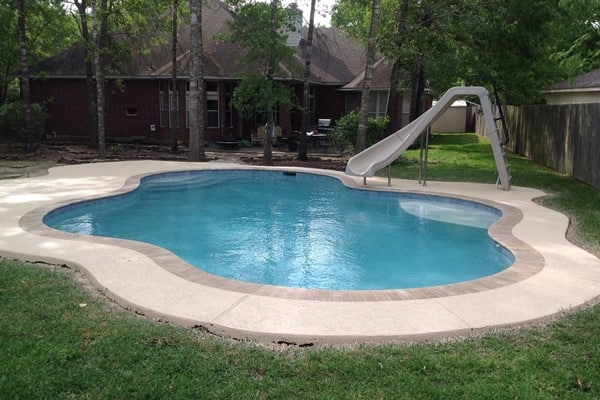 There is much to consider when installing a swimming pool in your yard, but a qualified pool professional can help with the decisions, says Lambert. (Photo courtesy of Angie's List member Patrick B. of Houston)