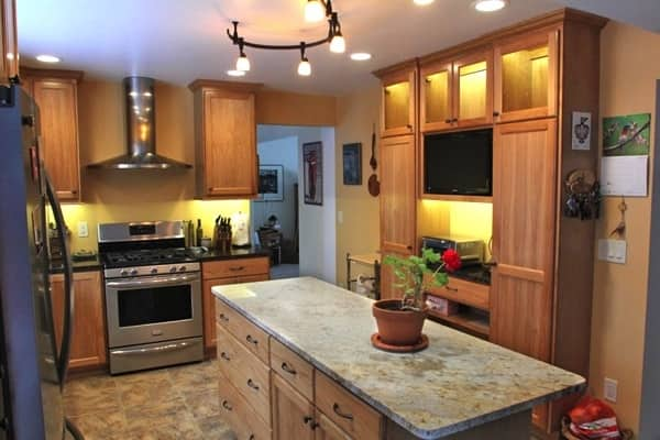 Apple Valley homeowners added custom cabinets to convert a 1970s peninsula cabinet layout with an open island design. (Photo courtesy of Angie's List member Ken Henningsen)
