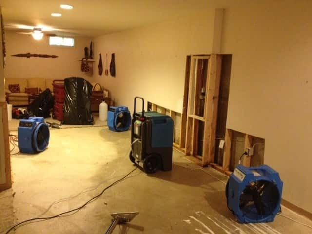 Wet carpet and drywall soaked with flood waters should be dried or removed immediately. (Photo courtesy of Angie's List member Jonjie S.)