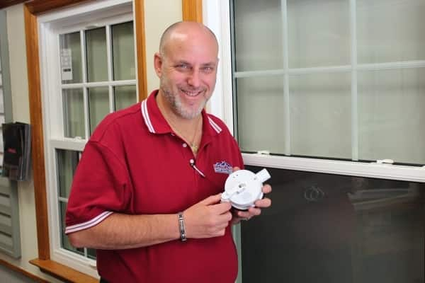 Window installation expert Mitch Kersch invented Forever Safe 'N' Sound, a portable safety lock with a built-in alarm parents can put on windows and sliding doors. (Photo courtesy of Major Home Corps, Oakland Gardens, N.Y.)