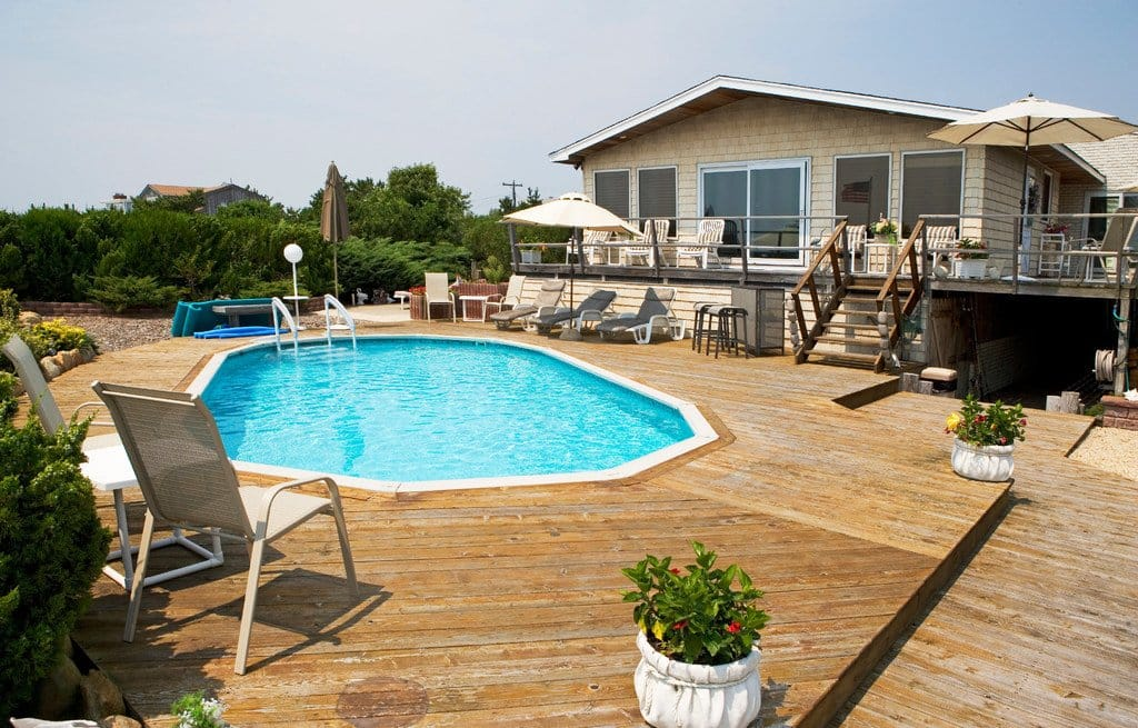 In-ground pool with wooden deck at beach house