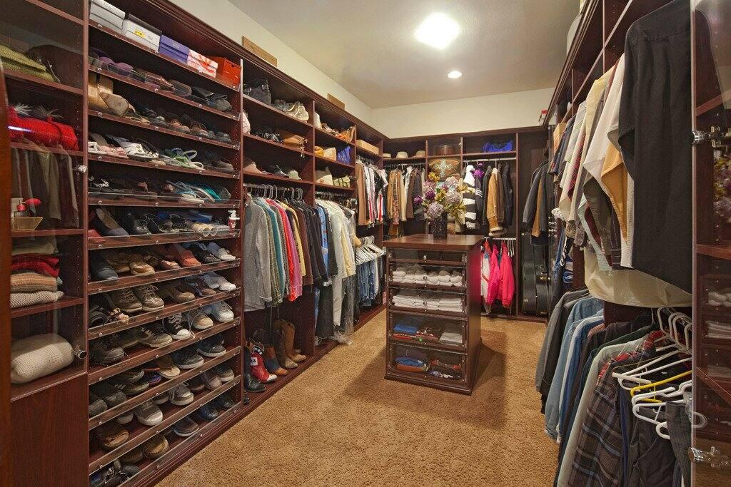 A large walk-in closet with slanted shoe racks & Walk in Closet Ideas \u0026 Walk in Closet Designs | Angie\u0027s List