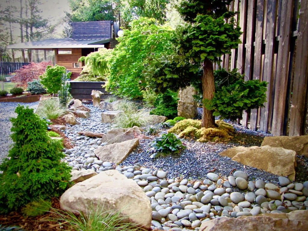 Zen Inspired Landscaping With Anese Trees And Rock Garden