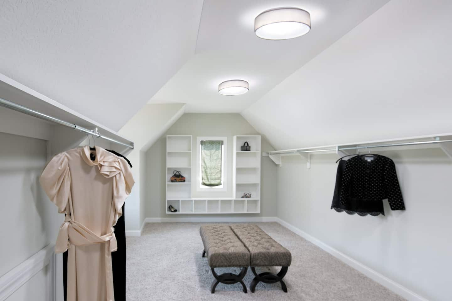 A walk-in closet with a solar tube skylight in the ceiling.