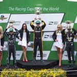 Winners of the Angie's List Grand Prix Celebrate on Podium