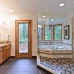 bathroom with large, tiled walk-in shower and soaking tub