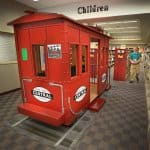 A fun reproduction of a New York Central caboose sits within the Beech Grove Public Library