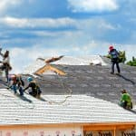 Roofers working on a roof
