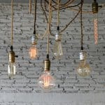 A variety of Eidsen-style bare bulbs hanging from cords from the ceiling