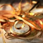 Gold ring on shiny pocket watch expensive jewelry