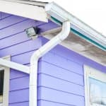 gutters and downspout on purple house
