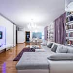 Modern apartment interior of a living room in white and purple tones