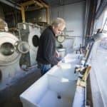 Underwood washing at sink
