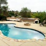 swimming pool with concrete deck