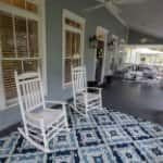 large front porch with rocking chairs and area rug