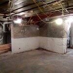 unfinished basement before remodel