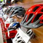 bicycle helmets hanging on wall