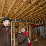 contractor and homeowner inspect construction site (Photo by Brandon Smith)