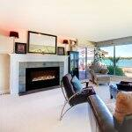 electric fireplace in living room with beach view