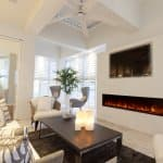 electric fireplace cozy beige sitting area with TV
