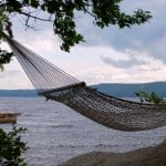 A hammock by a lake