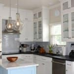 Complete kitchen remodel with light fixture and tile backsplash