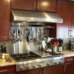 kitchen remodel with stainless steel backsplash