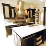 kitchen remodel with granite countertops and natural stone flooring