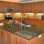 kitchen with granite countertops and tile backsplash