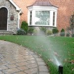 lawn irrigation system outside house (Photo by Photo courtesy of member Emily K. )