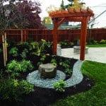 pergola by rock garden