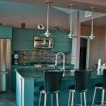 Gallery kitchen with blue soapstone and glass tile color accents