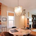 pearl disc chandelier over kitchen table