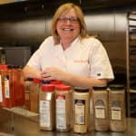 Chef Suzanne posing with spices