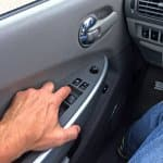 finger pressing car power windows button